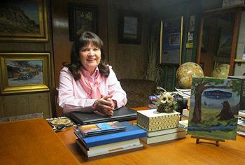 Vicki at her desk
